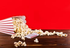 Red and White Bucket Of Popcorn With Two Red Movie Tickets. Movie Night Close Up On Red Stock Photos