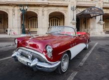 Red and white Buick convertible parked in front of Havana Opera. Havana, Cuba, Nov 21, 2017 - 1950`s Classic American Red and white Buick convertible parked in royalty free stock photography