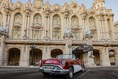 Red and white Buick convertible parked in front of Havana Opera. Havana, Cuba, Nov 21, 2017 - 1950`s Classic American Red and white Buick convertible parked in royalty free stock images