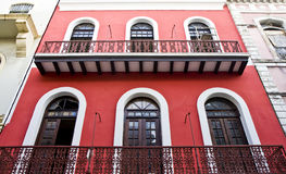Red and White Building with Red Iron Railing Royalty Free Stock Photos