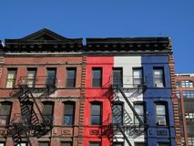 Red White and Buildings. This is a shot of a couple of colorful and patriotic painted apartment buildings located in Manhattan stock images