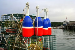 Red, White, and Buoy. Red, white, and blue lobster buoys and lobster traps Stock Photo