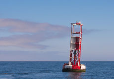 Red and White Buoy In Calm Water Stock Photos