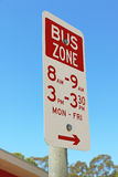 Red and white Bus Zone sign in a blue sky Royalty Free Stock Photo