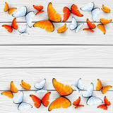 Red and white butterflies on wooden background Stock Images