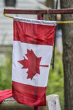 Canadian flag outside a home. Canadian flag flying outside a home Stock Photography