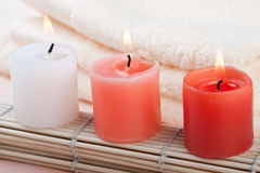 Red and white candles. Red pink and white candles in spa setting Royalty Free Stock Photography