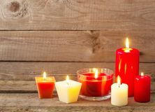 Red and white candles on dark wooden background Stock Photography