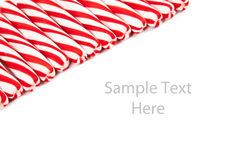 Red and white candy canes on white with copy space Royalty Free Stock Image
