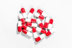 Red and white pills stock photos