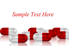 Red and White Capsules for text and background Stock Photos