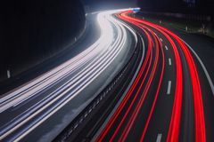 Red and white car light trails. Red and white car trail lights on highway royalty free stock photos