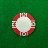 Red and white Casino chip on green Royalty Free Stock Image