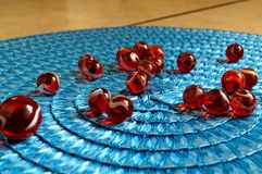 Red and White Cats Eye Marbles on blue mat. Toys. Games. Fun. Challenge stock image