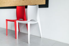 Red and white chairs on the white. Stock Images