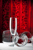Red white champagne glasses on a table Stock Photos
