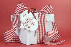 Red and white check gift on red background and love heart gift tag, Stock Image