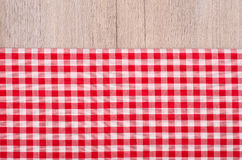 Red and white checkered cloth on wood. As background Royalty Free Stock Photos