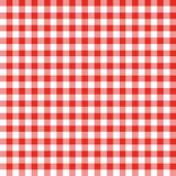 Red and White Checkered Fabric. Seamless background pattern of large red and white checks like a country tablecloth Stock Images