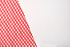 Red and white checkered fabric on white table top Royalty Free Stock Photo