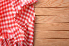 Red and white checkered fabric on white table top Royalty Free Stock Photos