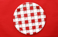 Red and White Checkered Plate. Isolated on red background Stock Image