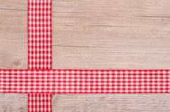 Red and white checkered ribbons on wood Stock Images