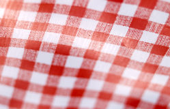 Red and white checkered table. Close up of wavy red and white checkered tablecloth with tight depth of field Royalty Free Stock Photography