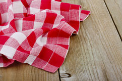 Red-white checkered tablecloth in an old wooden Royalty Free Stock Photo