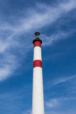 A red and white chimney with blue sky Royalty Free Stock Images
