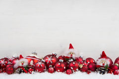 Red and white christmas background of wood with balls and goblin Royalty Free Stock Photography