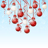 Red and white Christmas balls with snow Stock Photos