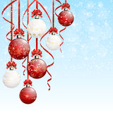 Red and white Christmas balls on snowy background Royalty Free Stock Photos