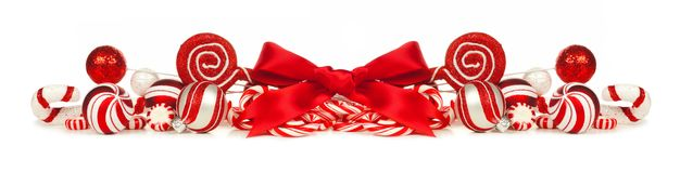Red and white Christmas baubles, bows and candy cane border Stock Image
