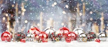 Red and white christmas baubles lined up 3D rendering. Red and white christmas baubles lined up on candel snowy background 3D rendering Stock Image