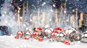 Red and white christmas baubles lined up 3D rendering. Red and white christmas baubles lined up on candel snowy background 3D rendering Stock Photos