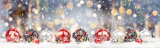 Red and white christmas baubles lined up 3D rendering. Red and white christmas baubles lined up on candel snowy background 3D rendering Stock Photo