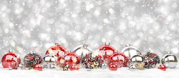 Red and white christmas baubles lined up 3D rendering. Red and white christmas baubles lined up on grey snowy background 3D rendering Stock Images