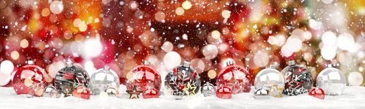 Red and white christmas baubles lined up 3D rendering. Red and white christmas baubles lined up on red snowy background 3D rendering Royalty Free Stock Photos