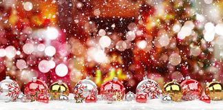 Red and white christmas baubles lined up 3D rendering. Red and white christmas baubles lined up on red snowy background 3D rendering Stock Image