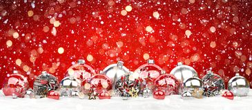 Red and white christmas baubles lined up 3D rendering. Red and white christmas baubles lined up on red snowy background 3D rendering Stock Photography