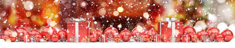 Red and white christmas baubles lined up 3D rendering. Red and white christmas baubles lined up on red snowy background 3D rendering Royalty Free Stock Images