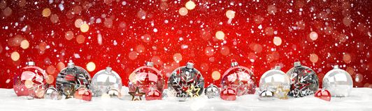 Red and white christmas baubles lined up 3D rendering. Red and white christmas baubles lined up on red snowy background 3D rendering Royalty Free Stock Image
