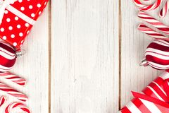Red and white Christmas border on white wood Stock Photos