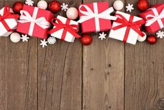 Red and white Christmas gift box top border over wood Royalty Free Stock Image