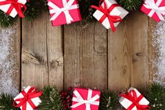 Red and white Christmas gift double border on rustic wood Stock Photos