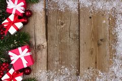 Red and white Christmas gift side border on wood Stock Image