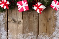 Red and white Christmas gift top border on wood Stock Photo