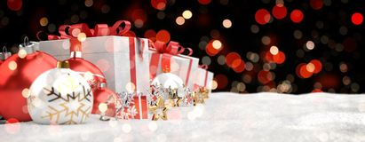Red and white christmas gifts and baubles lined up 3D rendering. Red and white christmas gifts and baubles lined up on black bokeh background 3D rendering Royalty Free Stock Photo