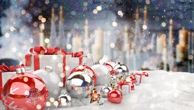 Red and white christmas gifts and baubles lined up 3D rendering. Red and white christmas gifts and baubles lined up on candels snowy background 3D rendering Stock Images